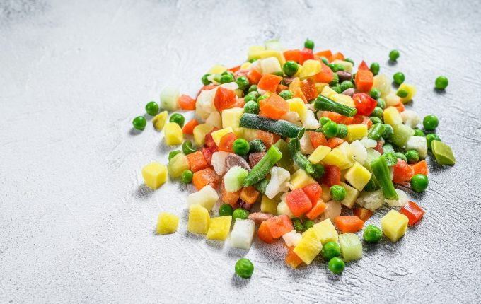 Frozen raw vegetables. Vegetarianism. White background. Top view.